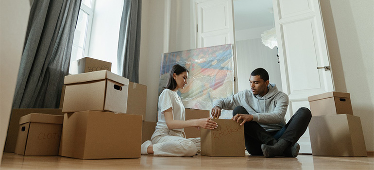 Two people unpacking after a move