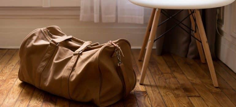a travel bag on the floor near a chair