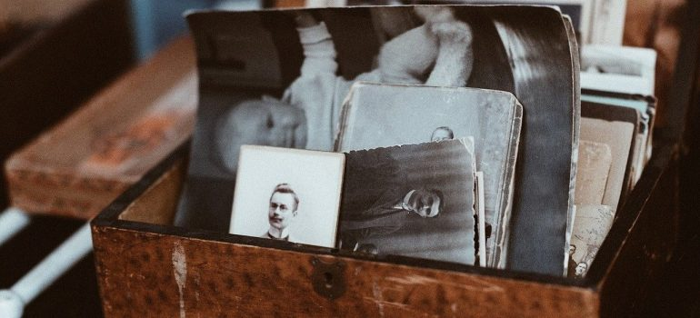 a wooden case with pictures inside