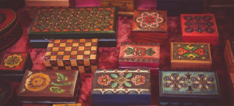 a couple of colorfully painted boxes