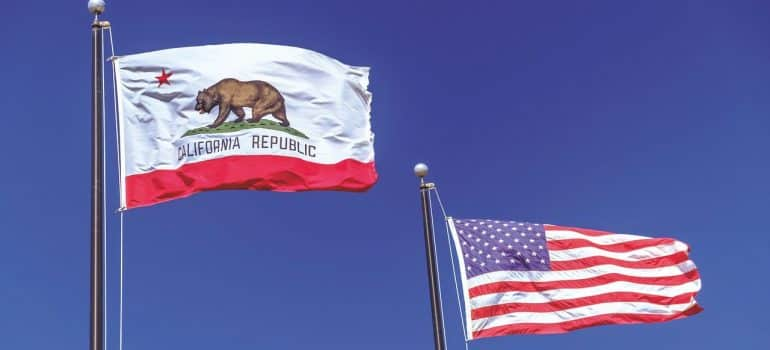 a flag of the state of California next to the flag of the United States of America