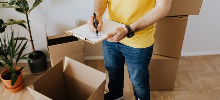 A mover making an inventory list