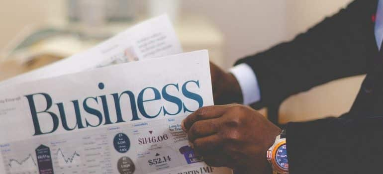 a man in a suit reading a business newspaper