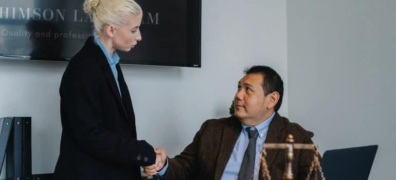a man and a woman shaking hands in an office