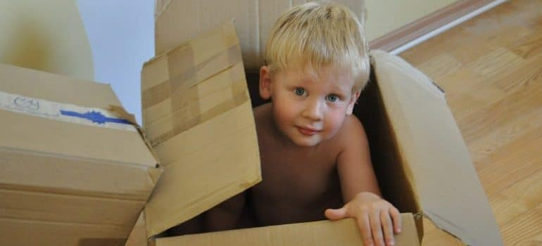 Help your kids adapt to Anaheim by playing hide and seek with them in boxes