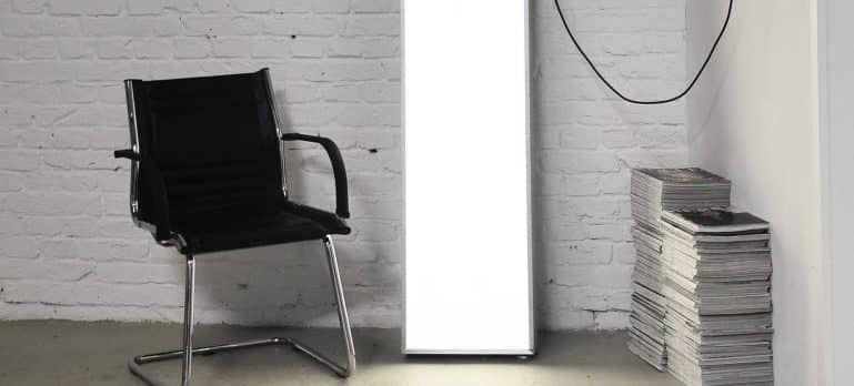 A chair, a mirror and magazines