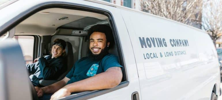 Two movers in a moving truck