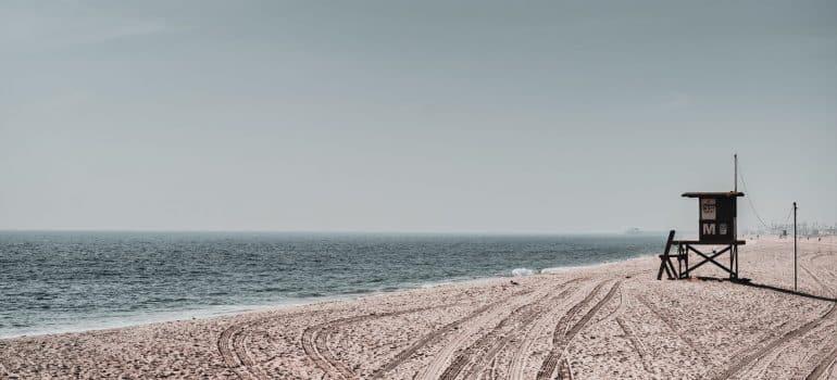 a lifeguard station on a sandy beach