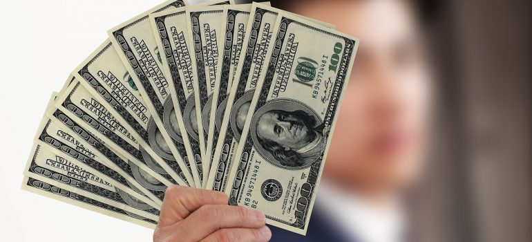 A man holding dollar bills.
