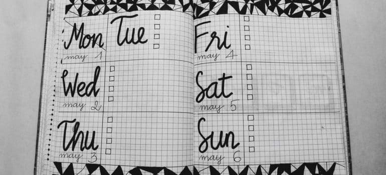 A notebook with a weekly plan to help plan a time-efficient relocation