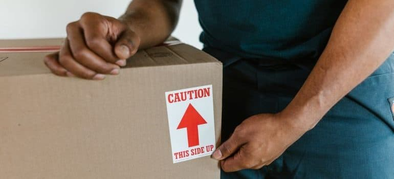 mover holding a box