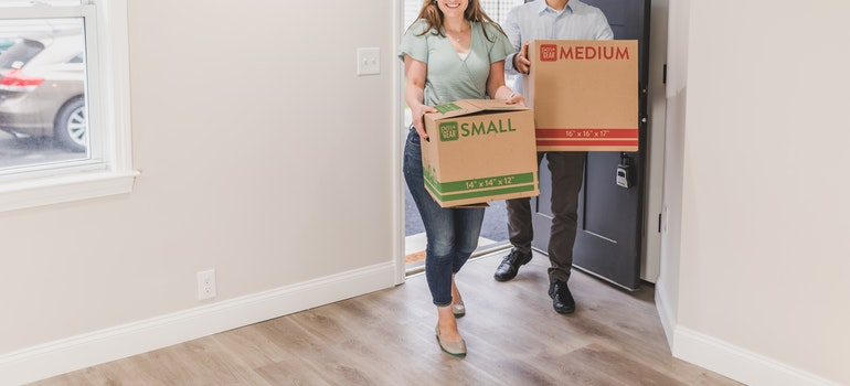 two people moving in after being helped by movers Fullerton