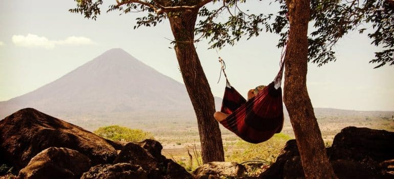 a man saving energy when moving by relaxing on a hammock